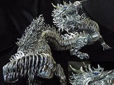 I love dragons...this one is made out of soda can tabs~