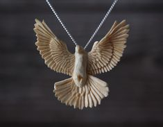 Hand carved Dove pendant by Giles Newman