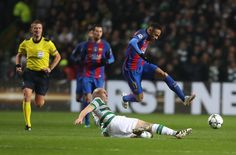 Neymar of Barcelona evades Scott Brown of Celtic during the UEFA Champions League match between Celtic FC and FC Barcelona at Celtic Park Stadium on November 23, 2016 in Glasgow, Scotland.