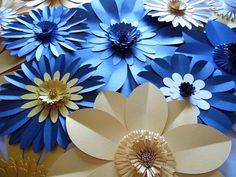 A set of beautiful giant pearlescent card flowers that can be used in many different settings such as for an amazing backdrop to your wedding photos, wedding venue decoration or a photo booth backdrop. The quality of these flowers mean that after your wedding day they can be reused in your home or for another event such as a christening!  This listing is for 15 flowers, approximate sizes are as follows: 5 x 20cm (8 inches) flowers 8 x 30cm (12 inches) flowers 2 x 40cm (16 inches) flowers…
