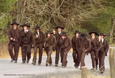 """Young Nebraska Amish men """"flipping off"""" the photographer. Supposedly, they think it mischievous, but don't know what it really means."""