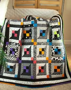 A great black & white quilt with a touch of color