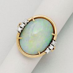 Opal, Diamond, Platinum and 14K Gold Ring, Birks   opal measuring 19.5 by 15.2 mm, 6 round diamonds totalling approx 0.20 ct