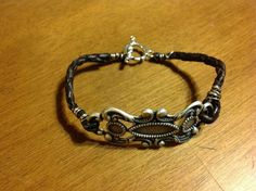 Silver design with brown leather bola cord