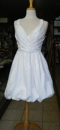 V neck Open back Cotton Eyelet Fun Wedding Dress handcrafted in Canada. $225.00, via Etsy.
