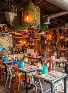 Thaikun Lively, ephemera-packed Thai joint with street-market furniture and an open kitchen, plus a tuk-tuk.