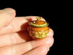http://www.ebay.co.uk/itm/Jane-Graber-Redware-Rare-bird-pot-Artisan-miniature-dolls-house-12th-scale-/222292702013?hash=item33c1ad733d:g:n3gAAOSwHMJYDtJ0