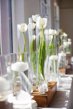 Atelier Joya | Laurent Studios- Love this, minimal, clean, flower design and the candles/ wood adds warmth