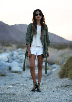 Fashion inspiration.  Street style.  White denim shorts with a simple and basic t shirt paired with an over-sized army green trench coat jacket and booties.