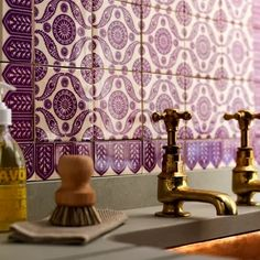Terrific patterned tile paired with brass fixtures. post: Pantone's Colour of 2014... Radiant Orchid! via Candana