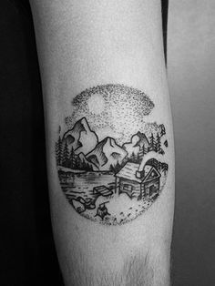 landscape tattoo of cabin, the lake and ice mountains