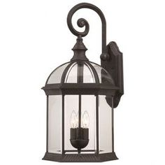 "Three-light outdoor wall lantern.   Product: Outdoor wall lanternConstruction Material: Glass and metalColor: Textured blackFeatures: Will enhance any decorFor outdoor useAccommodates: (3) 60 Watt type B incandescent bulbs - not includedDimensions: 26.25"" H x 13"" W x 12.5"" D"