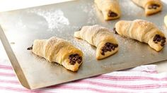 Chocolate-Filled Crescents~~~~ 1 can oz) Pillsbury™ refrigerated crescent dinner rolls cup mini-chocolate chips Powdered sugar, if desired (fall recipes crescent rolls) Crescent Roll Recipes, Crescent Rolls, Crescent Dough, Easy Desserts, Delicious Desserts, Dessert Recipes, Breakfast Recipes, Mini Desserts, Breakfast Time