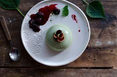 White chocolate matcha panna cotta with rosewater cherry sauce