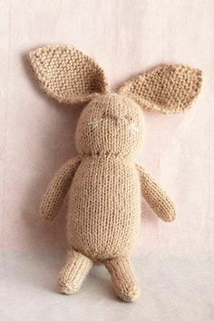 Knit Little Bunny - free pattern. I think this would be really adorable with brighter colors on the embroidered face (and maybe longer legs?).