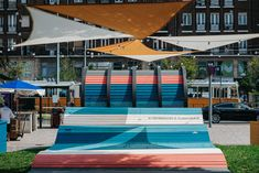 Image 4 of 26 from gallery of Hello Wood's POP-UP Park Adds a Splash of Color to an Underused Square in Budapest. Budapest, Hello Wood, Pop Up, Pedestrian, Elle Decor, Color Splash, Ads, Gallery, Outdoor Decor