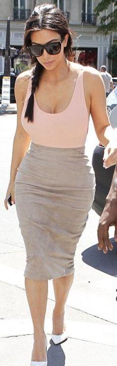 Kim Kardashian: Shirt – American Apparel; skirt – Ermanno Scervino; shoes – Gianvito Rossi; sunglasses – St. Laurent
