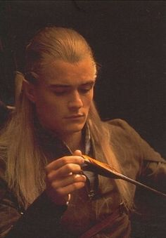 """""""He stands not alone,"""" said Legolas, bending his bow and fitting an arrow with hands that moved quicker than sight. """"You would die before your stroke fell."""""""