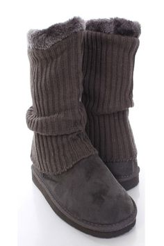 Be comfy yet stylish this season with these fashionable ankle boots! They will go perfect with your favorite sweater dress or skinnies! Make sure you add these to your closet, it definitely is a must have! The features include faux suede upper with a knitted sleeve shaft, faux fur trim, stitched detailing, round closed toe, slip on design, soft faux fur lining, and cushioned footbed. Approximately 14 1/2 inch circumference and 8 1/2 inch shaft.
