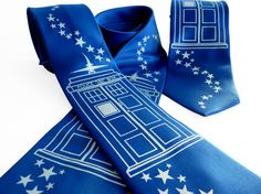 Be at your dapper best as you dash through space and time in our brilliant blue TARDIS inspired tie. Perfect gift for the Doctor Who fan and clever time traveler in your life.  Silk-screened by hand in white ink onto a sapphire blue necktie. We use only high-quality, non-toxic and eco-friendly,...