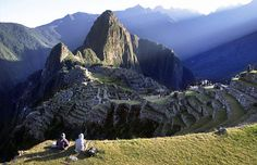 """Machu Picchu, Peru...  The fabled """"lost city of the Incas"""" sprawls on a jungle ridge in the Andes, a four-hour train ride northwest from Cuzco. Its sun-worshipping 15th-century builders aligned dawn's first rays with mountains, columns and a sundia"""