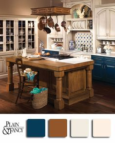 Old Time Classic Kitchen using an exciting dark blue with a mix of classic whites and darker natural brown stain for the island.  #color #traditional #white #blue #brown #kitchen #cabinets #design #palette