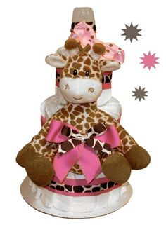 Our Sweet Giraffe Diaper Cake Pink is a 3 tier non edible cake constructed of 40 Premium size 1 diapers. Hand constructed to include a plush stuffed giraffe and bright pink and giraffe print ribbons and bows our Sweet Giraffe Diaper Cake Pink is sure to dazzle as a centerpiece as well as get put to good use when the baby arrives. The completed diaper cake arrives in crisp clean cellophane making for a beautiful and clean presentation. Our diaper cakes are carefully made so each diaper is ...