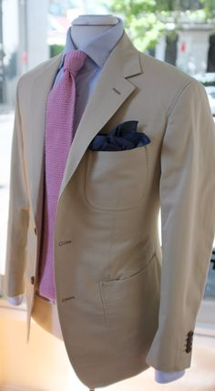 Beige jacket, white shirt with light blue dress stripes, pink knit tie