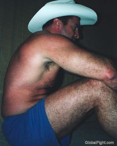 hairy legged cowboy sitting down