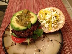 Quick Black Bean Burger myrecipes.com  1 hamburger bun,torn into pieces  3 T. olive oil, divided  2 t. chopped garlic  1 can black beans, rinsed and drained  1 t. grated lime rind  3/4 t chili powder  1/2 t. chopped fresh oregano  1/4 t. salt  1 lg. egg, lightly beaten  1 lg. egg white, lightly beaten