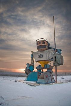 """This statue of a guardian type robot near Odessa in Ukraine is made from old, junked cars, among other things.  Apparently it was constructed by a logistics company called TIS (Transinvestservice) in order to serve as a signpost of sorts.  Now, instead of telling visitors to take a left at the 161km post, they can just say """"Turn when you come upon awesomeness."""""""