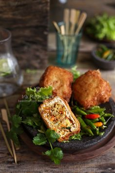 Deep-fried Stuffed tofu **Tahu isi**  these are vegan w an egg free batter. I bake mine w/o batter instead of frying, sometimes I use per fried tofu bits I get from any Asian market. I like to stuff w mushrooms.