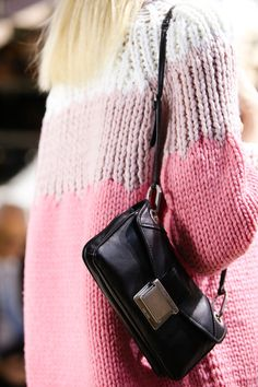 The pairing of thick and thin yarn in this Miu Miu knit pullover creates a unique and modern look!