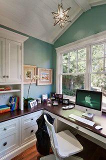 Built-in, desk under window, drawers & cabinets to the side. Nice wooden desktop.