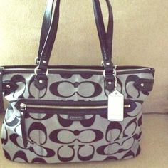 Authentic Coach Purse Excellent Condition.....Very Clean Interior and Exterior... Grey/Black With Silver Lined C's .  Large and Roomy( too big for me.  I lose everything in it). Leather Black Straps Long Enough to Throw Over Shoulder.  Huge Front Zip Pocket. Coach Bags