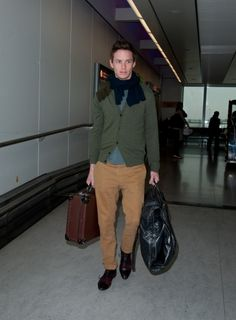 Les Miserables actor Eddie Redmayne arrives at Heathrow Airport after attending the Oscars. #airport #celebrity #style #fashion #actor #travel #looks
