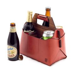 By far the most distinctive way to stock up on craft beer at your local store, the Sixfold Leather Beer Carrier is made of vegetable-tanned English Bridle leather and American walnut that come to Club Colombia, Craft Bier, Beer Packaging, Bottle Carrier, Beer Gifts, Bottle Holders, Bottle Crafts, Beer Bottle, Sewing Crafts
