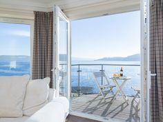 This luxury penthouse apartment is located at the waters edge and boasts stunning views.