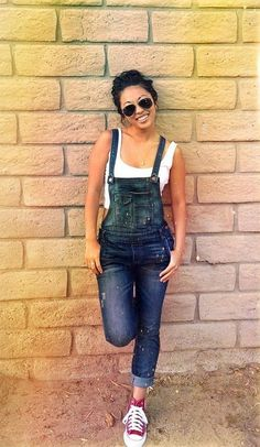 Shop this look on Lookastic:  http://lookastic.com/women/looks/black-sunglasses-red-high-top-sneakers-navy-overalls-white-cropped-top/8449  — Black Sunglasses  — Red High Top Sneakers  — Navy Denim Overalls  — White Cropped Top