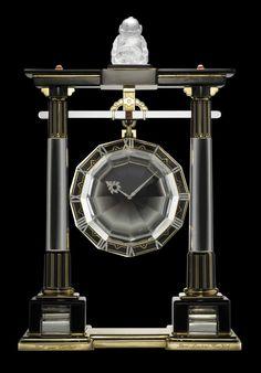 Large Portique Mystery Clock, Cartier Paris, 1923 Cartier Paris, 1923 Yellow gold, platinum, rock crystal, rose-cut diamonds, onyx, coral cabochons, black enamel Square, 8-day double-barrel movement, gold-plated, 13 jewels, bimetallic balance, Breguet balance spring