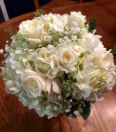 Wintery mix. Shades of white roses and hydrangea. Holland Daze Weddings