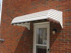Step down door canopy.  For year around protection, aluminum window awnings and door canopies are probably the most popular type of awnings.