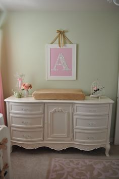 Great way to save $$$. Paint an old dresser, update the handles, and make it into a changing table!