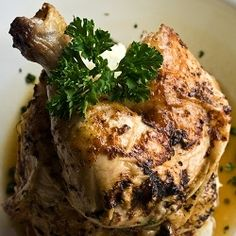 """Chicken cooked with pomegranate, coriander and mint from a 4,000 year old Mesopotamian recipe. Also: chicken/pigeon, salt, water, fat, vinegar, semolina, leek, garlic, shallots, tulip bulb, yogurt or sour cream, and """"greens""""."""