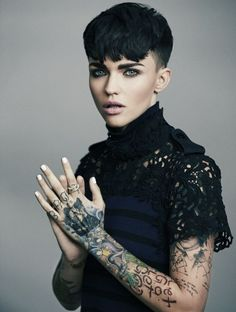 One of the breakout stars of 'Orange is the New Black' season three is Ruby Rose. The Australian beauty shows off a more glamorous side than prison uniforms with a new photo shoot for Byrdie. In the images captured by Justin Colt, Ruby flaunts her many ta Ruby Rose Tattoo, Rose Tattoos, Orange Is The New Black, Short Pixie, Pixie Cut, My Hairstyle, Rose Hair, Girl Crushes, Hair Inspiration