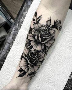Blackwork floral forearm tattoo by @dmitriy.tkach