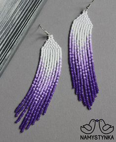 These Violet pantone beaded earrings are made of high-quality Czech beads and strong synthetic thread. They are elegant, fashionable, and highly versatile, suitable for everyday wear. Features: Sterling silver components Color: violet, white. This item is currently in stock. You must be