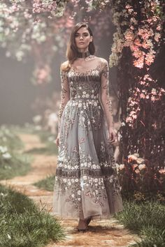 PSS/S1810 – Tulle sleeved tea-length gown with organza paneling, featuring woodland embroidery and the lyrics of Sleeping Beauty's, 'Once Upon A Dream'.