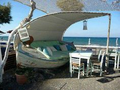 Boat recycled into a cool patio lounge area. I want one!