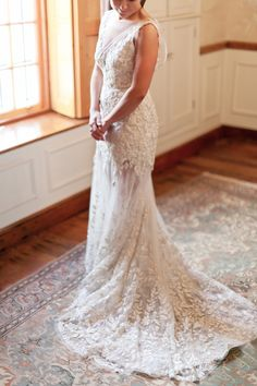 Kobus Dippenaar Illusion Lace wedding dress - gorgeous! | SouthBound Bride | http://www.southboundbride.com/elegant-floral-marquee-wedding-by-moira-west-joyle-jp | Credit: Moira West